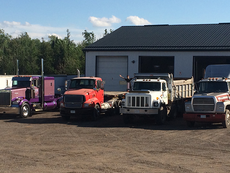 close up of trucks at Leslie's Equipment