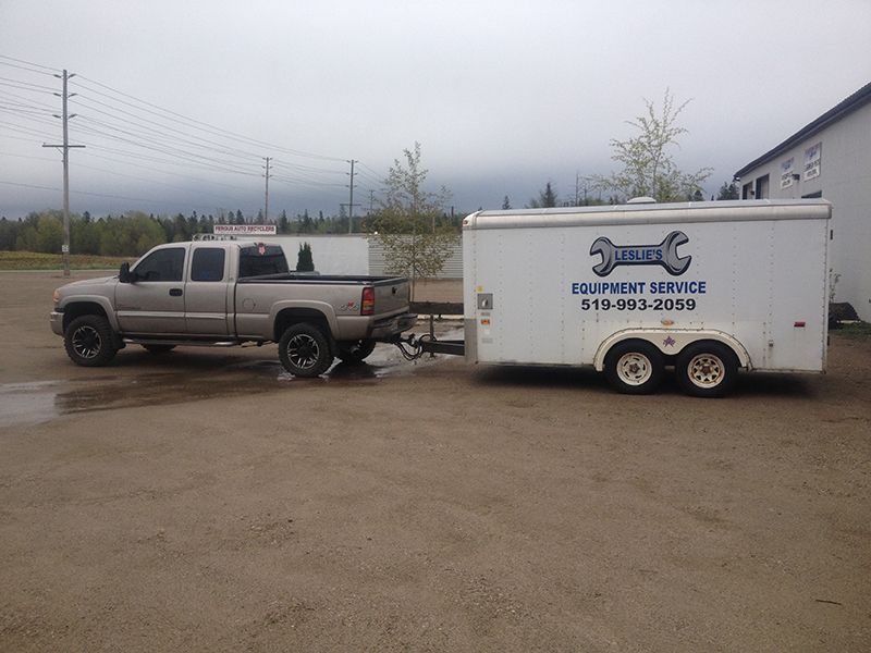 Leslie's Equipment Service logo on trailer behind truck